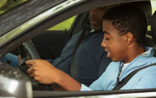 Teenager driving a car