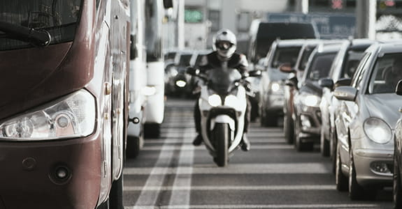 Motorcycle being ridden between two rows of traffic
