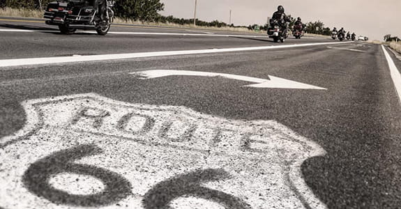 Route 66 logo painted onto a black top road