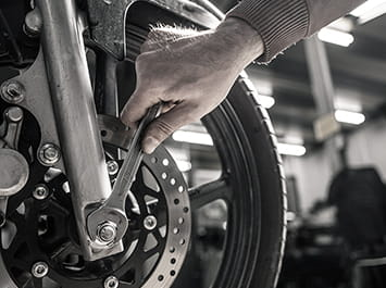 Using a wrench on a front motorcycle tire