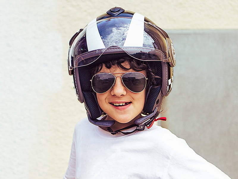 Kid wearing motorcycle helmet