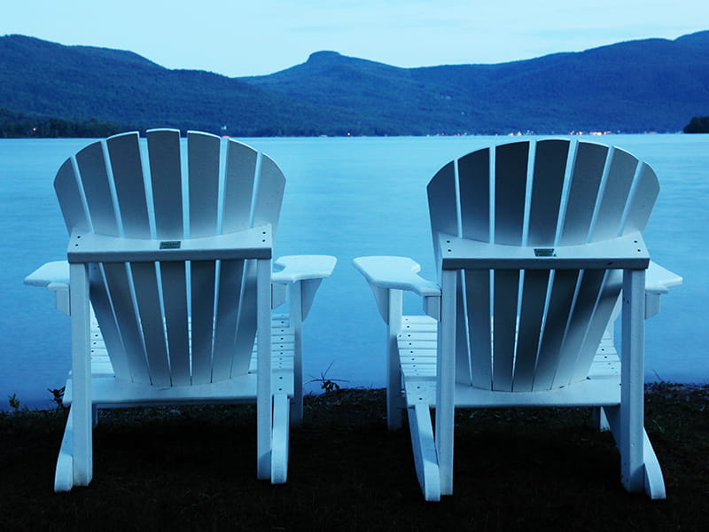 Chairs next to a lake