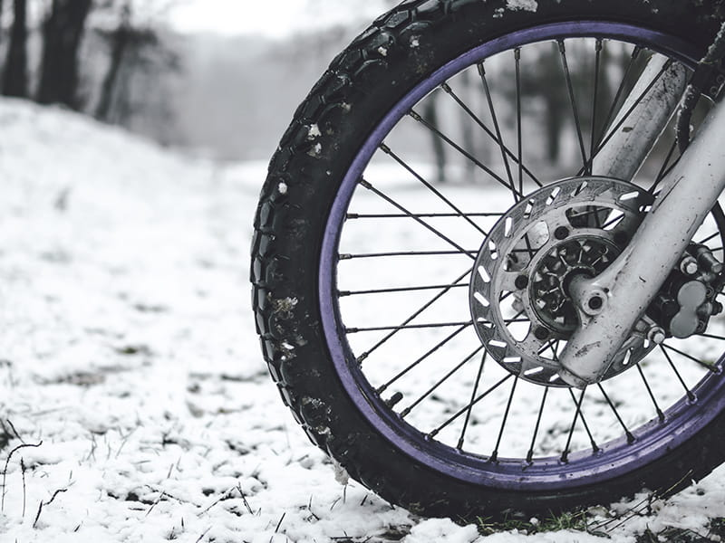 Front tire of motorcycle on snow