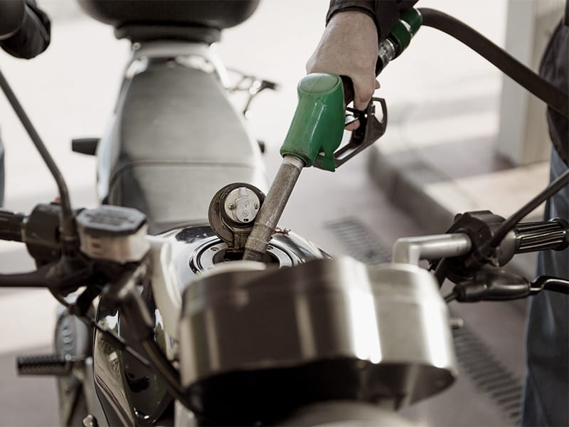 Putting gas into motorcycle tank