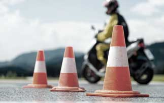 Motorcycle riding around safety cones